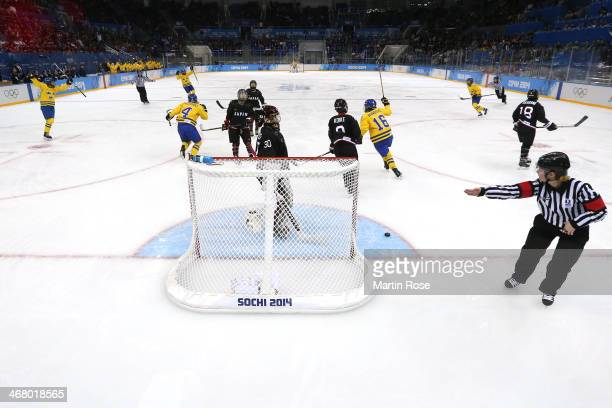 Jenni Asserholt of Sweden celebrates scoring the first goal with her teammates during the Women's Ice Hockey Preliminary Round Group B Game on day...