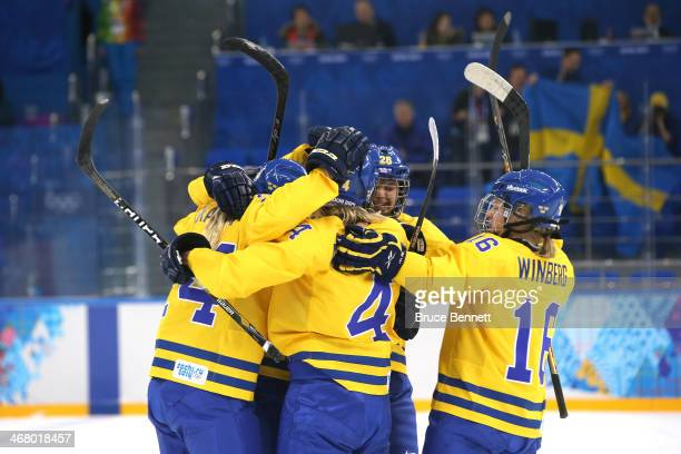 Jenni Asserholt of Sweden celebrates socring the first goal with her teammates during the Women's Ice Hockey Preliminary Round Group B Game on day...