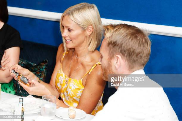 Jenni Falconer and James Midgley attend Casamigos Tequila's Away for August private dinner at Bagatelle on July 31 2018 in London United Kingdom