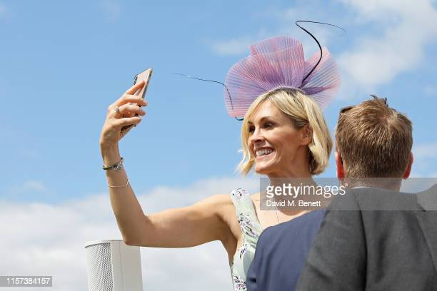 Jenni Falconer and James Midgley in the Village Enclosure on day 4 of Royal Ascot at Ascot Racecourse on June 21 2019 in Ascot England