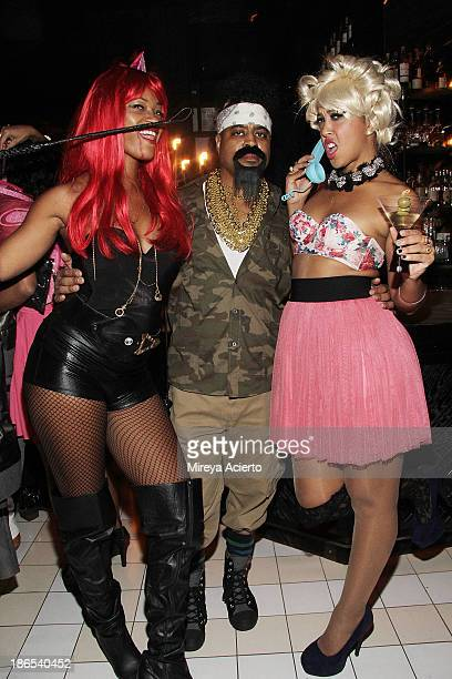 Jenni Fly Marvin Johnson and Drea Jean attend Halloween at Bar Nana with Acria and Flaunt Magazine at Bar Nana on October 31 2013 in New York City