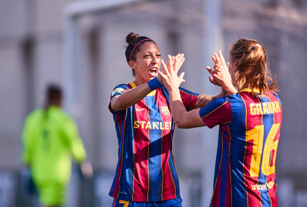 Jenni Hermoso of FC Barcelona celebrates scoring her team's fifth goal with Caroline Graham Hansen during the La Liga match between Real Betis and FC...