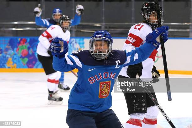 Jenni Hiirikoski of Finland celebrates after scoring a goal against Florence Schelling of Switzerland in the first period during the Women's Ice...
