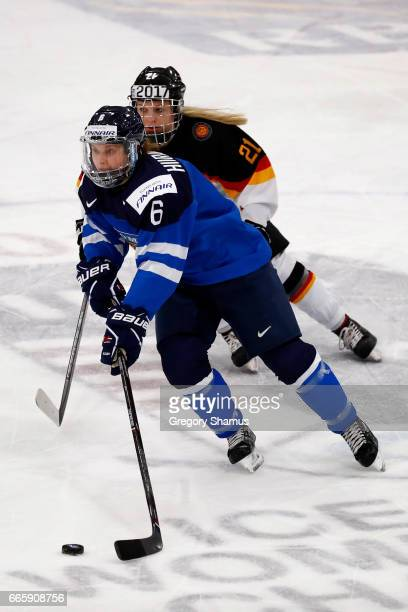 Jenni Hiirikoski of Finland heads up ice in front of Ronja Jenike of Germany during the first period in the bronze medal game at the 2017 IIHF...