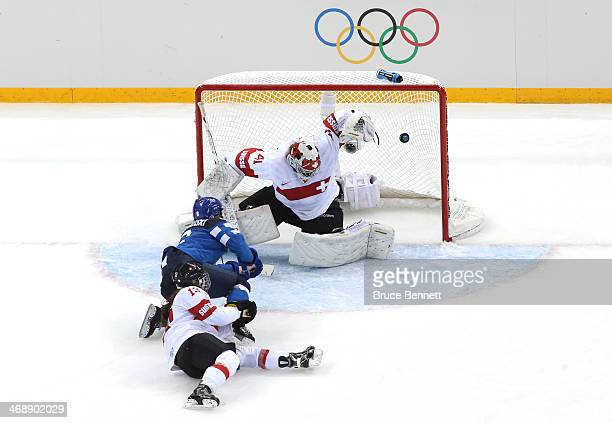 Jenni Hiirikoski of Finland scores the game winning goal in overtime to against Florence Schelling of Switzerland to defeat them 4 to 3 in the...