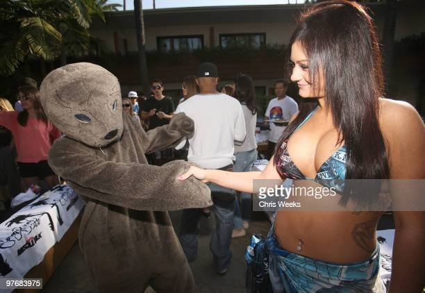 Jenni ''JWoww'' Farley and a manatee attend Muscle Milk's Springbreakitdown.com pool party at The Roosevelt Hotel on March 13, 2010 in Hollywood,...