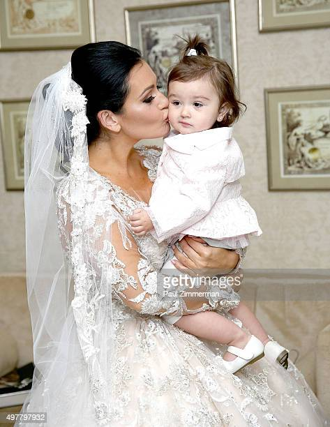 Jenni 'JWoww' Farley and daughter Meilani Alexandra Mathews pose for wedding pictures at the wedding of television personalities Jenni 'JWoww' Farley...