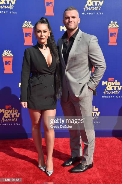 Jenni 'JWoww' Farley and Zack Clayton Carpinello attend the 2019 MTV Movie and TV Awards at Barker Hangar on June 15, 2019 in Santa Monica,...
