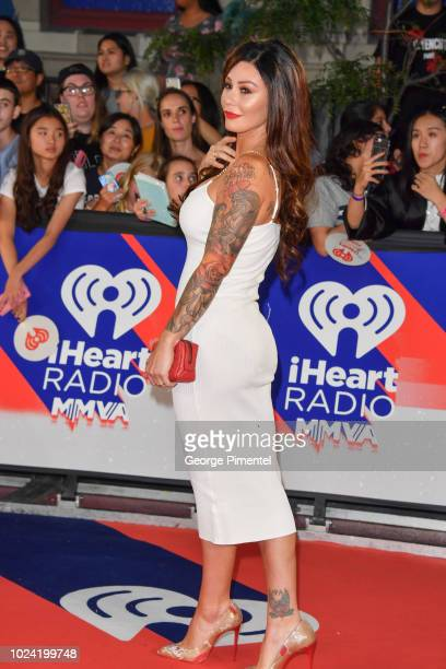 """Jenni """"JWOWW"""" Farley arrives at the 2018 iHeartRADIO MuchMusic Video Awards at MuchMusic HQ on August 26, 2018 in Toronto, Canada."""