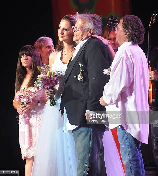 Jenni Maurer and Leslie West of Mountain get married onstage during Heros of Woodstock Tour on the 40th anniversary of Woodstock at the Bethel Woods...