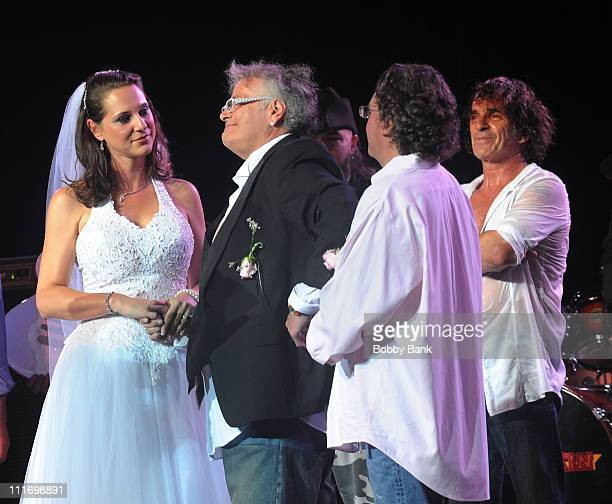 Jenni Maurer and Leslie West of Mountain get married onstage with Corky Laing looking on during Heros of Woodstock Tour on the 40th anniversary of...