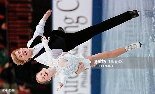 Jenni Meno and her husband Todd Sand perform in the championship pairs competition 07 January in the 1998 US Figure Skating Championships in...