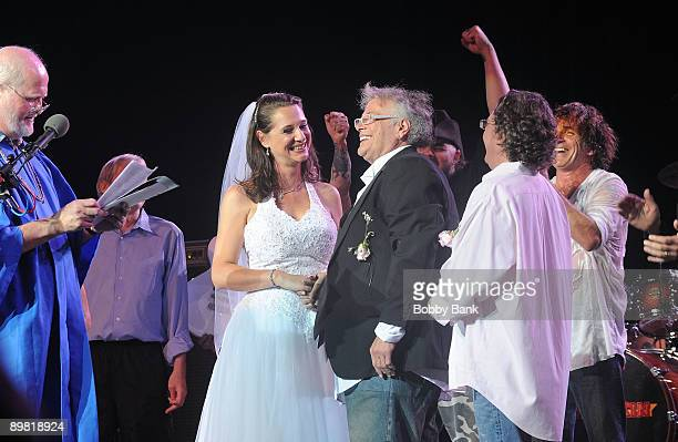 Jenni Muldaur and Leslie West of Mountain get married on stage during Heros of Woodstock Tour on the 40th anniversary of Woodstock at the Bethel...
