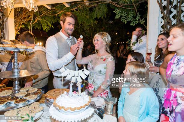 Jennie Garth and Dave Abrams cut the pie at their wedding at a private residence July 11 2015 in Santa Ynez California