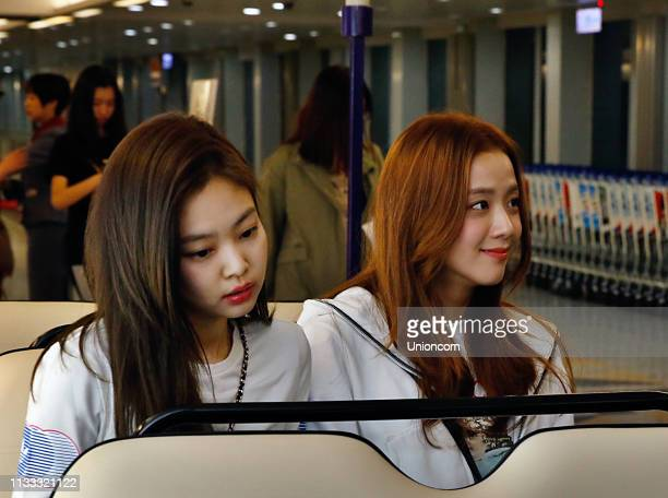 Jennie Kim and Jisoo of South Korean girl group Blackpink arrive at an airport on March 2 2019 in Taipei Taiwan of China