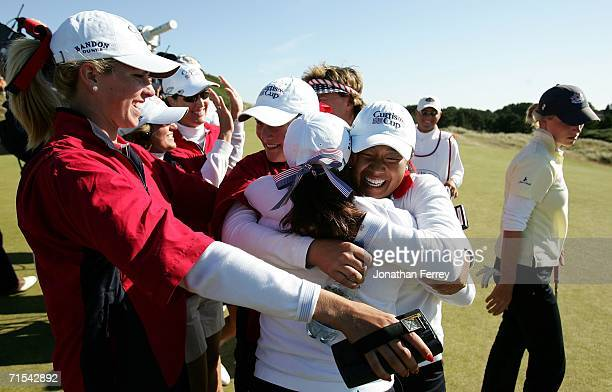 Jennie Lee of the United States is hugged by teammates Taylor Leon and Jenny Suh after clinching the winning point with her 3 and 2 victory over...