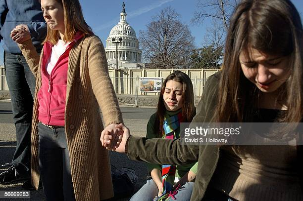 Jennie Nelson left and Missy Martinez center pray with fellow antiabortion activists during the March for Life prayer vigil in front of the Supreme...
