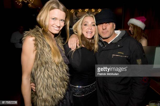 Jennie Norberg Anna Rothschild and Mark Baker attend Socialite Anna Rothschild's Annual Christmas Party at Velour Lounge on December 14 2010 in New...