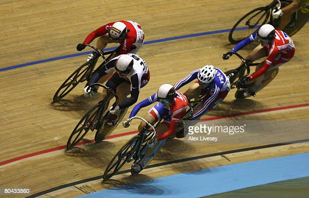 Jennie Reed of USA battles with Victoria Pendleton of Great Britain on her way to victory in the Women's Keirin Final during the UCI Track Cycling...