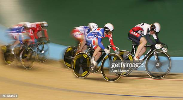 Jennie Reed of USA powers past Victoria Pendleton of Great Britain on her way to victory in the Women's Keirin Final during the UCI Track Cycling...
