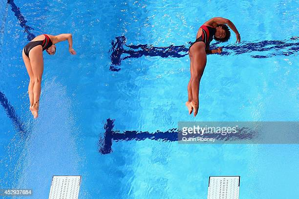 Jennifer Abel and Pamela Ware of Canada compete in the Women's Synchronised 3m Springboard Final at Royal Commonwealth Pool during day seven of the...