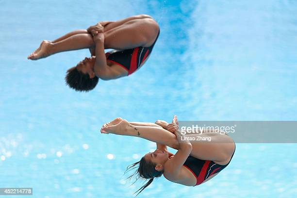 Jennifer Abel and Pamela Ware of Canda compete in the Women's 3m Springboard Synchro Final on day Two of the 19th FINA Diving World Cup at the...