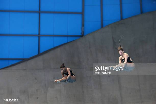 Jennifer Abel and synchro partner Melissa Citrini Beaulieu of Canada compete in the Women's 3m Synchro Springboard Final during day one of the FINA...