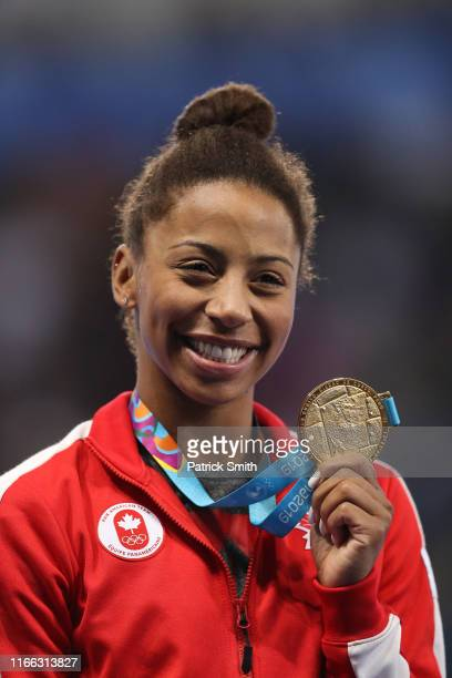 Jennifer Abel of Canada celebrates with the gold medal after winning the Women's Diving 3m Springboard Final on Day 10 of Lima 2019 Pan American...