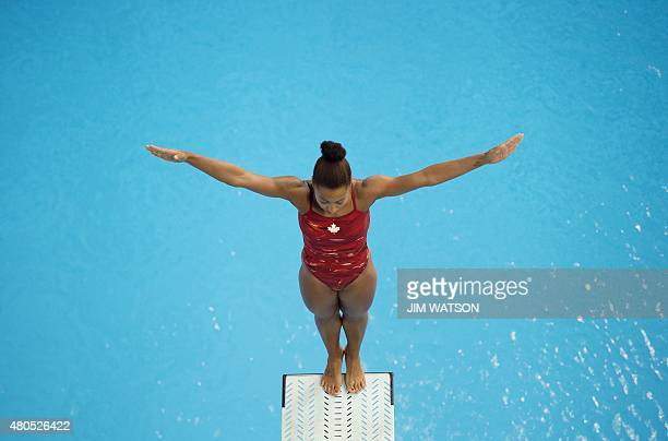 Jennifer Abel of Canada competes in the Women's 3M Springboard finals at the 2015 Pan American Games in Toronto Canada July 12 2015 AFP PHOTO/ JIM...