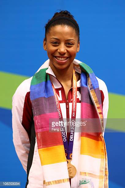 Jennifer Abel of Canada poses with the gold medal won in the Women's 1m Springboard Final at Dr SP Mukherjee Aquatics Complex on day nine of the...