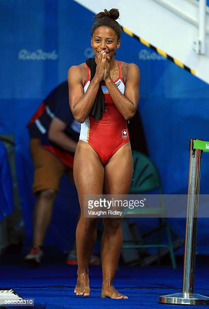 Jennifer Abel of Canada reacts as she sees her last dive score in the Women's 3m Springboard Final on Day 9 of the Rio 2016 Olympic Games at the...