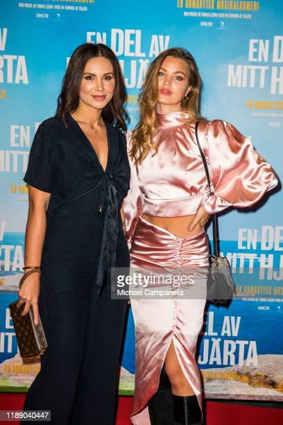 Jennifer Akerman and guest pose for a picture on the red carpet during the premiere for A Piece Of My Heart at the Rigoletto cinema on December 16...