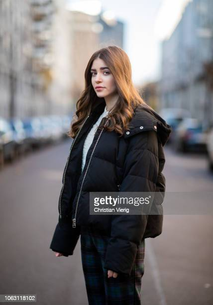 Jennifer Amanda is seen wearing a mixed texture sweater by Other Stories checkered trousers by Loavies black Kanna down jacket by Gestuz Addict...