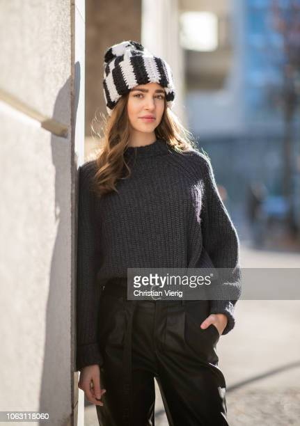 Jennifer Amanda is seen wearing Edited knit black leather look trousers LOAVIES Closed x F Girbaud belt black classic Dr Martens boots on November 17...