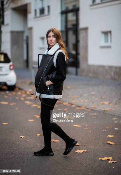 Jennifer Amanda is seen wearing leather vest by BeEdgy striped Emma Gestuz denim jacket orange Edited shirt basic leggings by NAKD x Nicki Studios...