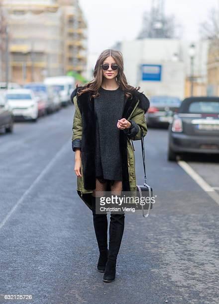 Jennifer Amanda wearing a grey mohair sweater from Zara a custom design parka from WELOVEPARKA overknee boots by Gardenia Copenhagen paired with...