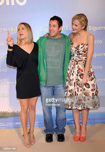 Jennifer Aniston Adam Sandler and Brooklyn Decker attend the premiere party of 'Sigueme el Rollo' at the Room Mate Oscar Hotel on February 22 2011 in...
