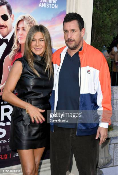 Jennifer Aniston and Adam Sandler attend the LA premiere of Netflix's Murder Mystery at Regency Village Theatre on June 10 2019 in Westwood California