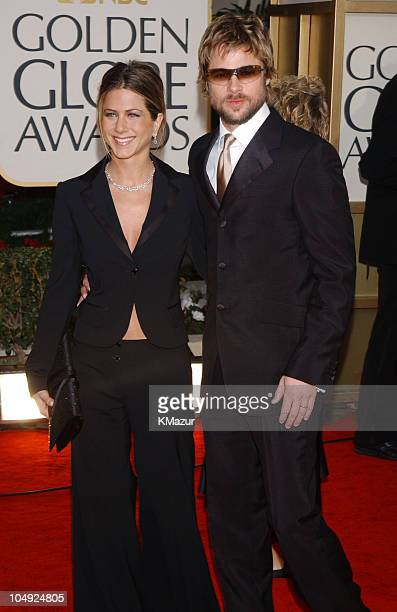 Jennifer Aniston and Brad Pitt arrive for the Golden Globe Awards at the Beverly Hilton Hotel in Beverly Hills California January 20 2002