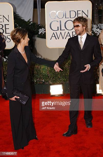 Jennifer Aniston and Brad Pitt during The 59th Annual Golden Globe Awards Arrivals at The Beverly Hilton Hotel in Beverly Hills California United...