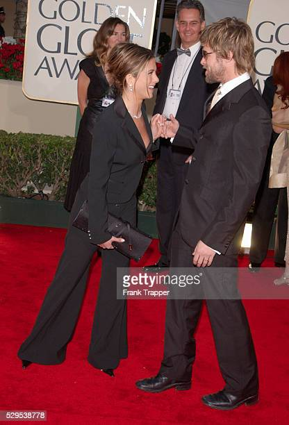 Jennifer Aniston and Brad Pitt have a laugh as they arrive at the 2001 Golden Globe awards