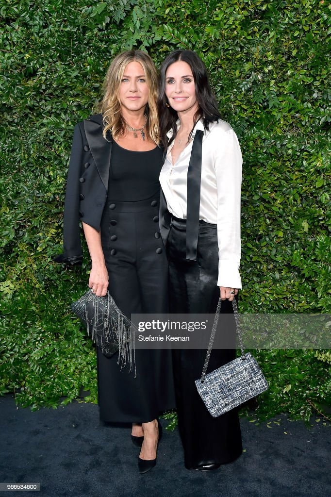 Jennifer Aniston (L) and Courtney Cox, both wearing Chanel, attend Chanel Dinner Celebrating our Majestic Oceans, A Benefit for NRDC at Private Residence on June 2, 2018 in Malibu, California.