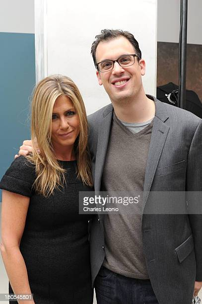 Jennifer Aniston and Daniel Schechter pose at the Guess Portrait Studio on day 9 of the 2013 Toronto International Film Festival at Bell Lightbox on...