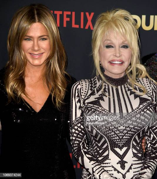 Jennifer Aniston and Dolly Parton arrive at the premiere of Netflix's 'Dumplin'' at the Chinese Theater on December 6 2018 in Los Angeles California