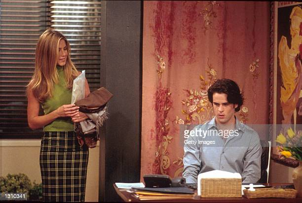 """Jennifer Aniston and Eddie Cahill act in a scene from """"Friends"""" ."""