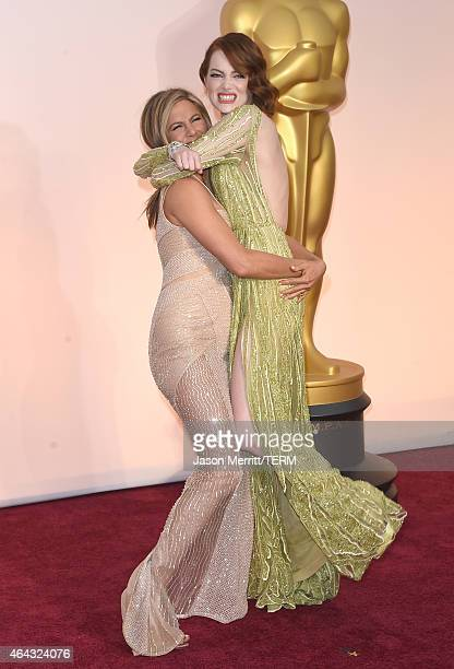 Jennifer Aniston and Emma Stone attend the 87th Annual Academy Awards at Hollywood Highland Center on February 22 2015 in Hollywood California