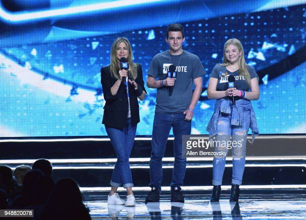 Jennifer Aniston and founders of the #neveragain movement and organizers of the March for our Lives Cameron Kasky and Jacqueline Coren speak onstage...