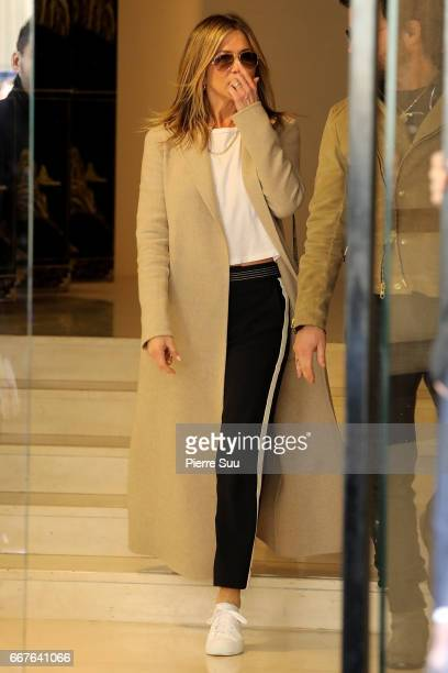 Jennifer Aniston and her husband Justin Theroux are seen leaving a Chanel store on April 12 2017 in Paris France