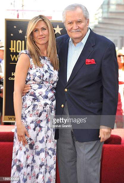 Jennifer Aniston and John Aniston attends the Jennifer Aniston Hollywood Walk Of Fame Induction Ceremony on February 22 2012 in Hollywood California