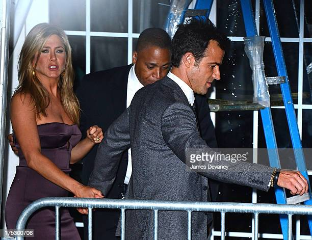 Jennifer Aniston and Justin Theroux leave the 'We're The Millers' New York Premiere at Ziegfeld Theater on August 1 2013 in New York City